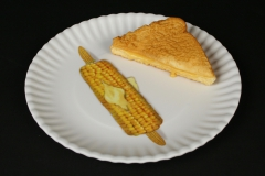 Mary Lake-Thompson white melamine plate with grilled cheese and corn on the cob