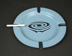 Whirlpool blue enamel ashtray with candy cigarette