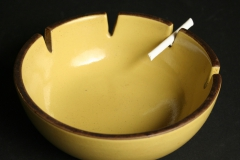 Heath Ceramics, mustard colored ashtray with candy cigarette
