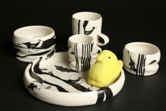 Janet DeBoos Children's dishes with magpies and yellow plush peep