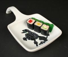 Glidden Pottery shirred egg server with sushi
