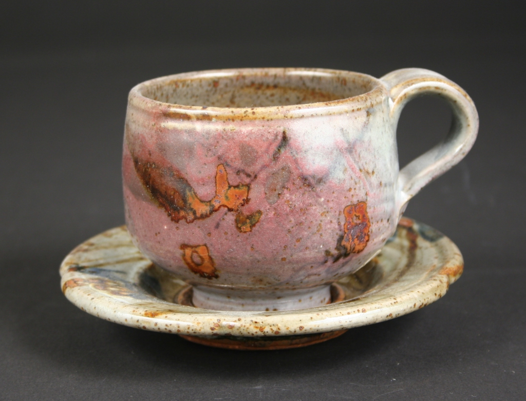 John Glick (American, 1938-2017), cup and saucer, part of a 6-piece place setting created by John Glick, 1979, commissioned by Walter and Joan Mondale for the Vice Presidential Mansion, stoneware, reduction fired, Cone 10, multiple slips & glazes, brush work/calligraphy, Gift of the Artist, 2014.70