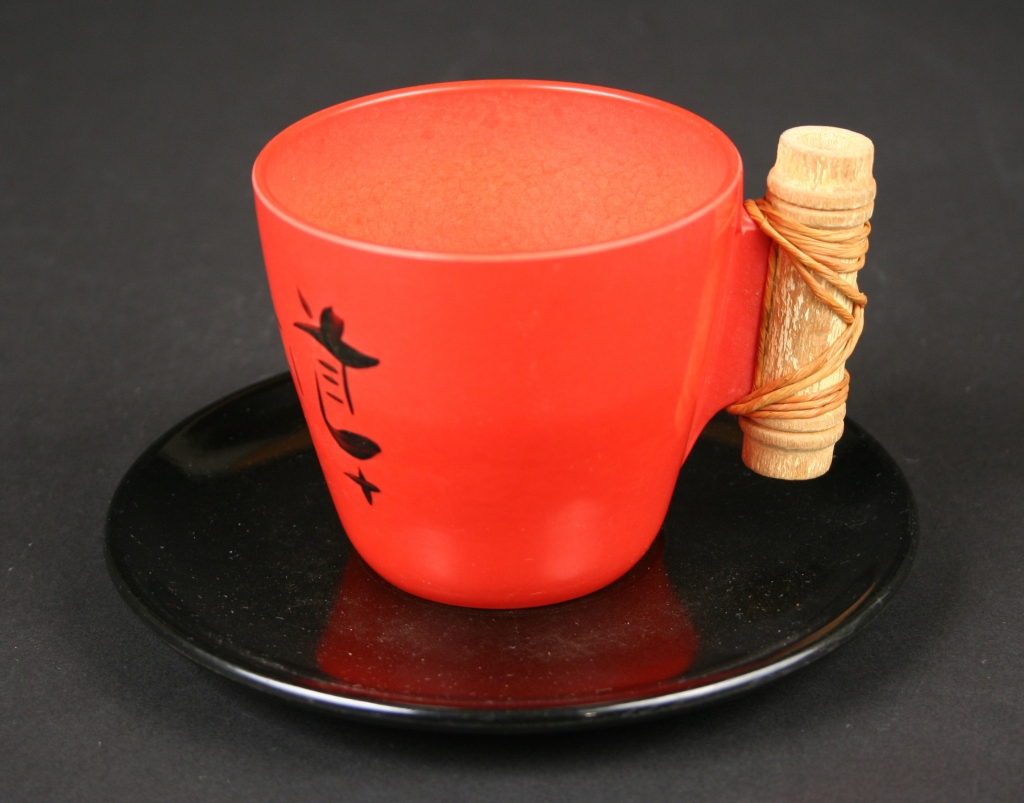 predecessor of Branchell, Co., St. Louis, Missouri (pre-1952), Kaye La Moyne, designer (American, 1918-1992), red melamine/plastic Ebonyte cup and saucer with bamboo handles and Oriental characters, ca. 1949-early 1950s, plastic, with bamboo handles on some pieces, Museum Purchase, 2019.104