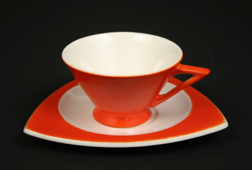 Salem China. Salem, OH (1898 - ), Vincent Bloomhall, Herbert Smith, Don Schreckengost, et al, designers), Mandarine Tricorne Art Deco orange cup and saucer, 1930s (patented), china, glazed, Gift of Margaret Carney and Bill Walker, 2019.174.