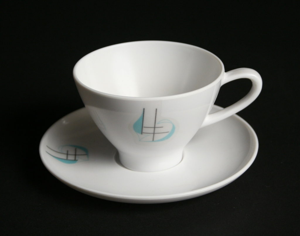 Prolon, Florence, Mass., manufacturer (established 1854), Irving Harper, designer (1916-2015), Regatta Melmac turquoise with a black on a white background, cup and saucer, 1958, plastic, Museum Purchase, 2016.177