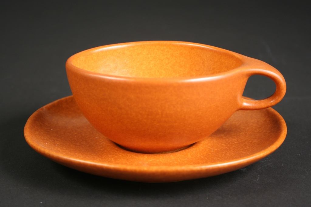 Raymor by Roseville, manufacturer, Roseville, Ohio (1890-1953), Ben Seibel, designer (1918-1985), terra cotta (pumpkin) Raymor Modern Stoneware cup and saucer, 1952-1954, stoneware, Ram-pressed, glazed, Museum Purchase, 2016.215