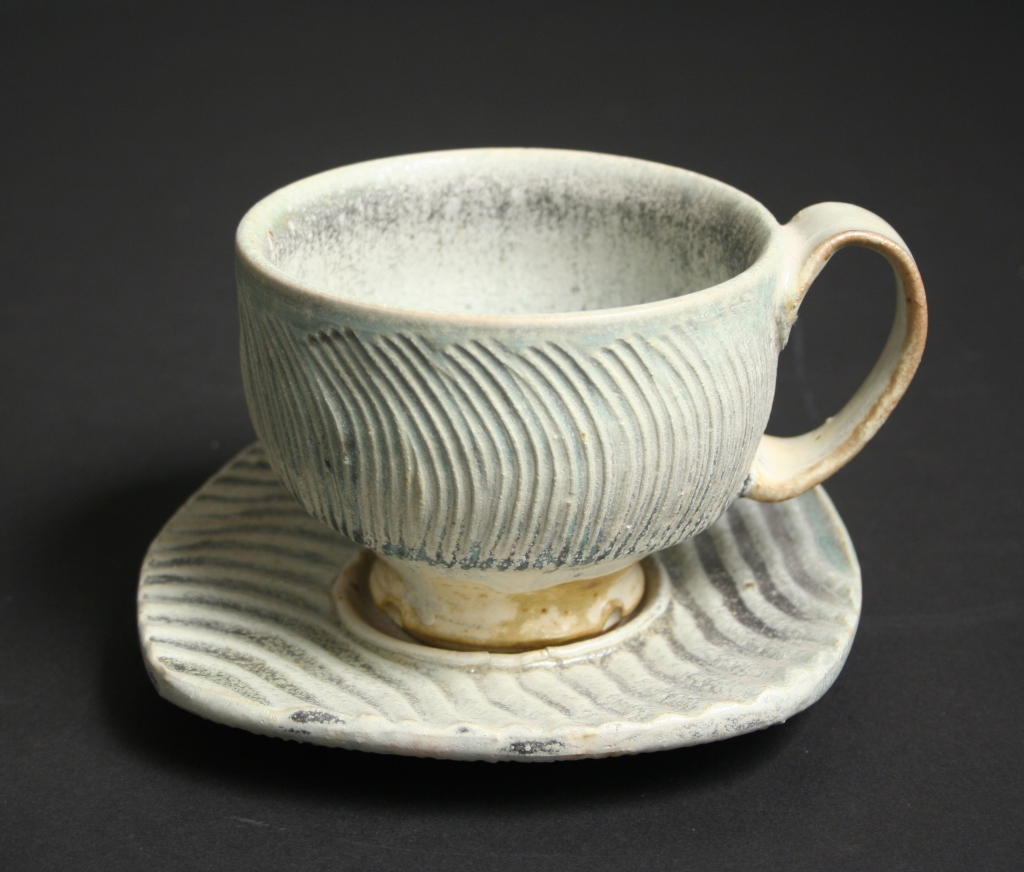 Robert Sutherland (American, b. 20th century), salt-fired stoneware cup and saucer with striations, 1990s, stoneware, salt-fired, Gift of Margaret Carney and Bill Walker, 2019.173