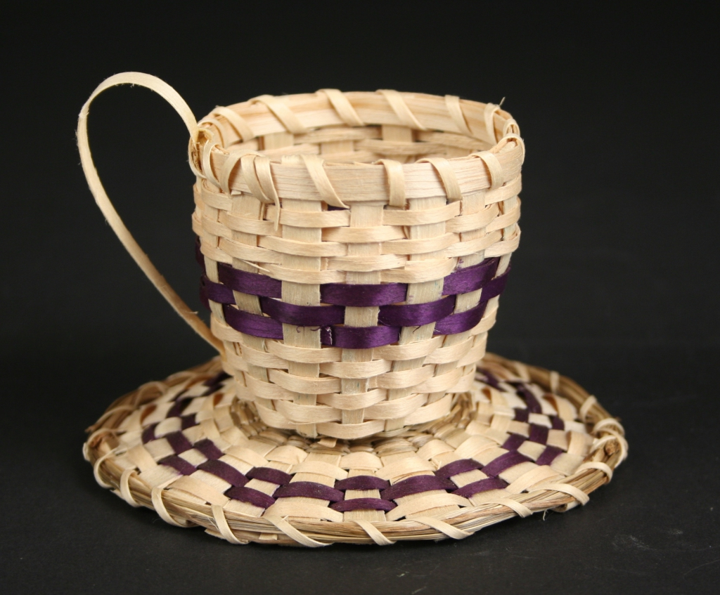 Robin Lazore, Mohawk basket maker (Native American, Akwesasne, a Mohawk community), Mohawk cup and saucer basketry, 2016, black ash and sweetgrass, woven with Welch's grape juice dye, Museum Purchase, 2016.55.