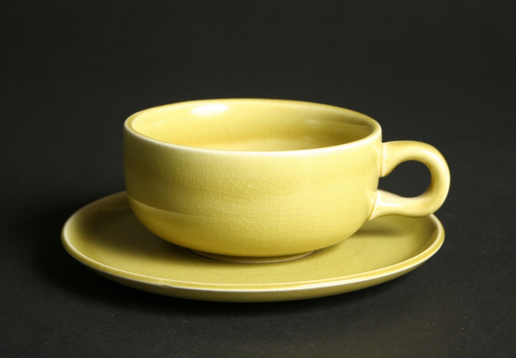 Steubenville Pottery Company, Steubenville, Ohio, manufacturer (1879-1959), Russel Wright, designer (American, 1904-1976), American Modern chartreuse cup and saucer set, ca. 1939, earthenware, glazed, Gift of Doris and Jim McEwen, 2013.40