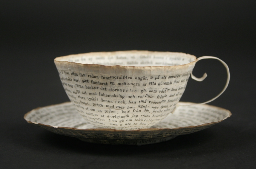 Cecilia Levy (Swedish), cup and saucer, paper art object, 2016, o;d book pages and wheat starch paste, Museum Purchase, 2016.16